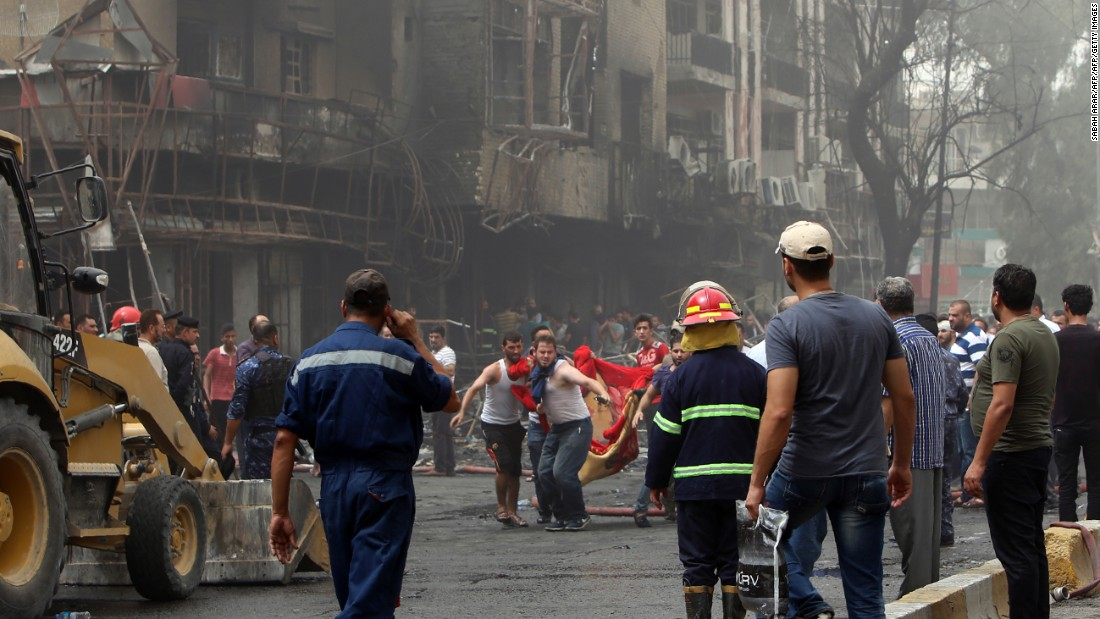 A body is carried away from the site of the blast.