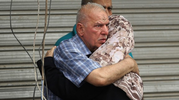 People hug near the site of the Karrada blast.