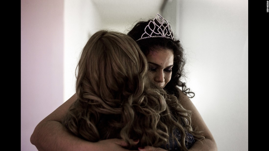 "Raquel Gimenez hugs a contestant before the Miss Gordita beauty pageant begins in Asuncion, Paraguay. Gimenez was the 2015 winner of the pageant, which translates to ""Miss Chubby"" in English. It was started to fight discrimination and improve the contestants' health."