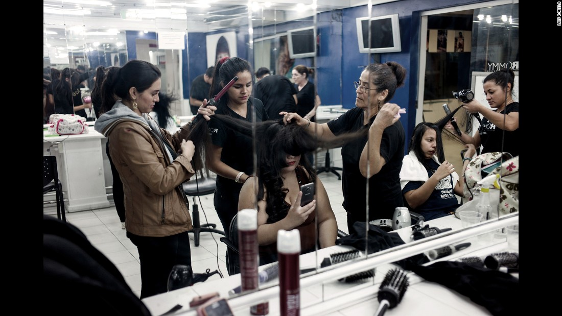 Contestant Micaela Arce has her hair done a few hours before the pageant.