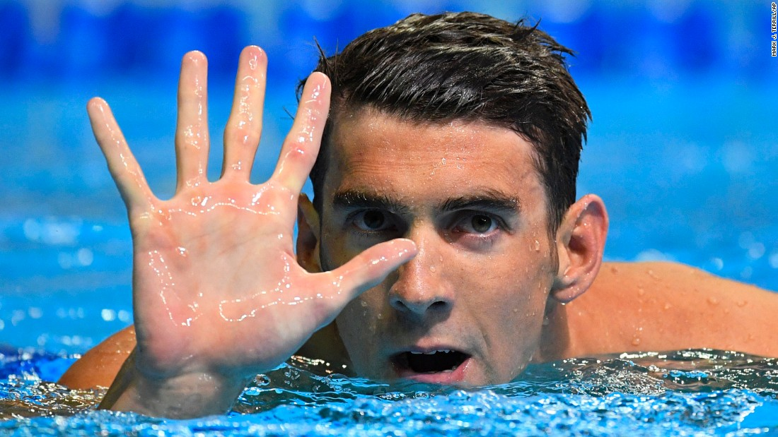 "Swimming legend Michael Phelps gestures after winning the 200-meter butterfly at the U.S. Olympic trials on Wednesday, June 29. He will be competing <a href=""http://www.cnn.com/2016/06/30/sport/michael-phelps-olympics-rio-trials/index.html"" target=""_blank"">in his fifth Olympic Games</a> next month."