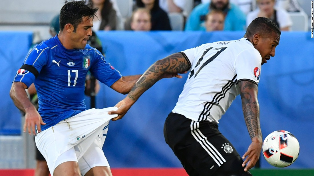 "German defender Jerome Boateng grabs the shorts of Italian forward Eder during a Euro 2016 quarterfinal match on Saturday, July 2. <a href=""http://www.cnn.com/2016/07/02/football/germany-italy-euro-2016/"" target=""_blank"">Germany advanced</a> after a dramatic penalty shootout."