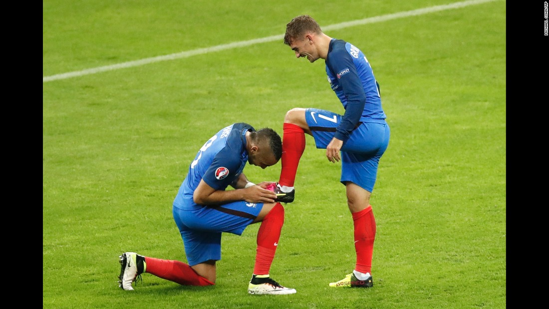 "Dimitri Payet kisses the boot of his French teammate, Antoine Griezmann, after Griezmann scored a goal against Iceland on Sunday, July 3. <a href=""http://www.cnn.com/2016/07/03/football/france-iceland-euro-2016-quarterfinal/"" target=""_blank"">France won 5-2 </a>to advance to the semifinals of Euro 2016."