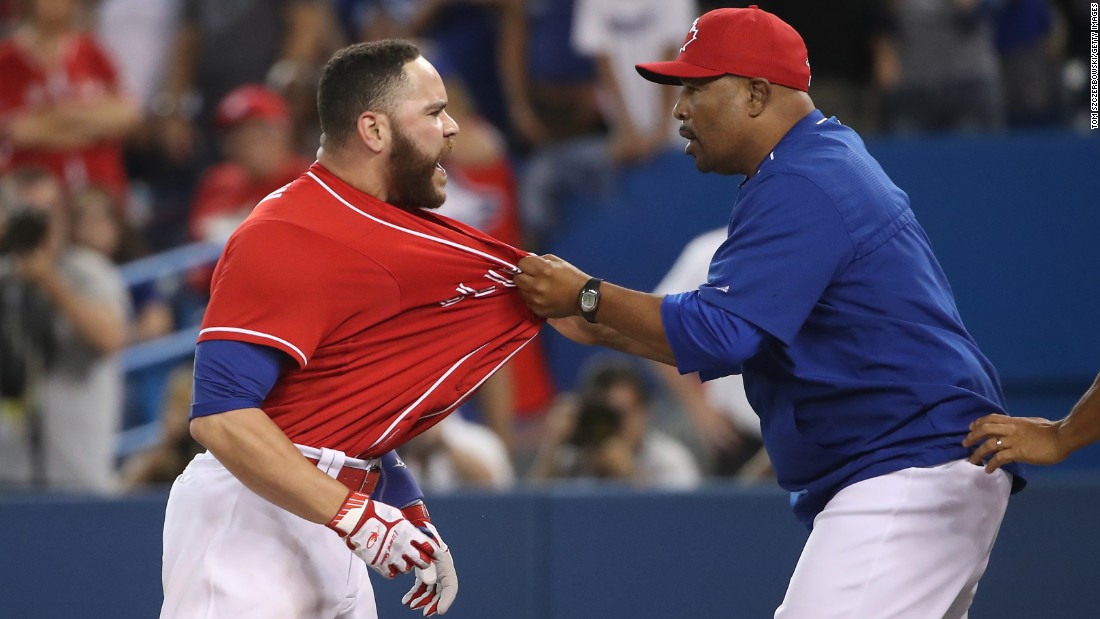 Toronto catcher Russell Martin is restrained by coach DeMarlo Hale after being ejected from a game on Friday, July 1. Martin was ejected for arguing a third called strike.
