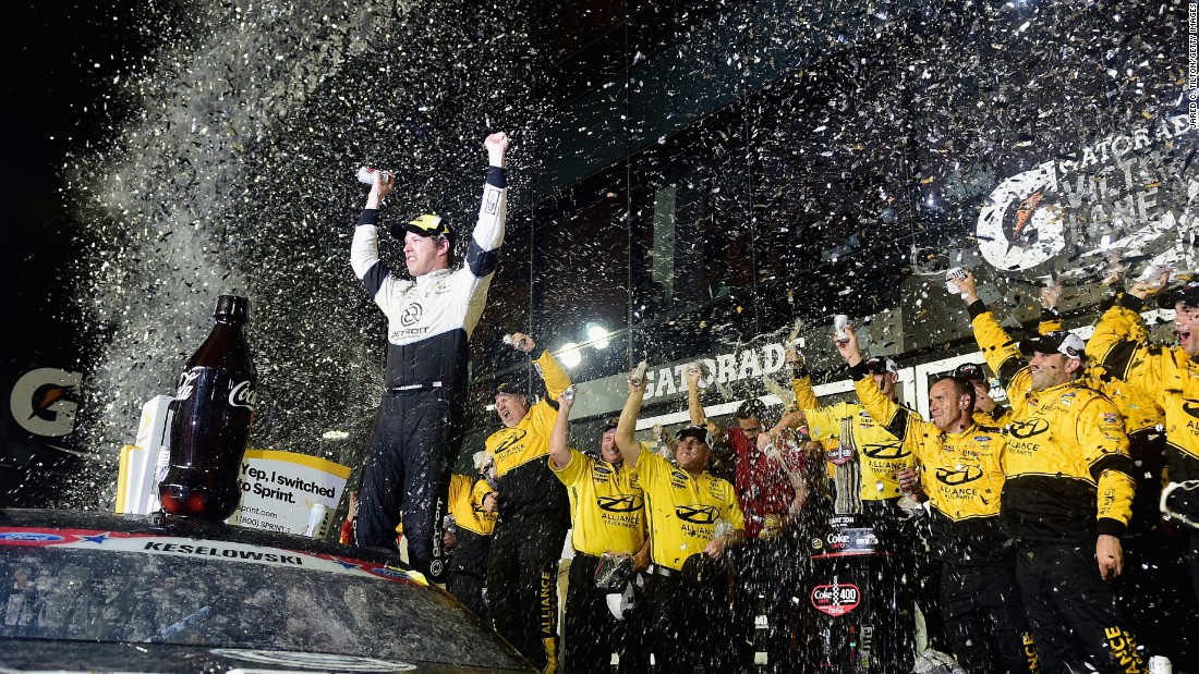 Brad Keselowski celebrates with his crew in Victory Lane after winning a Sprint Cup in Daytona Beach, Florida, on Saturday, July 2.
