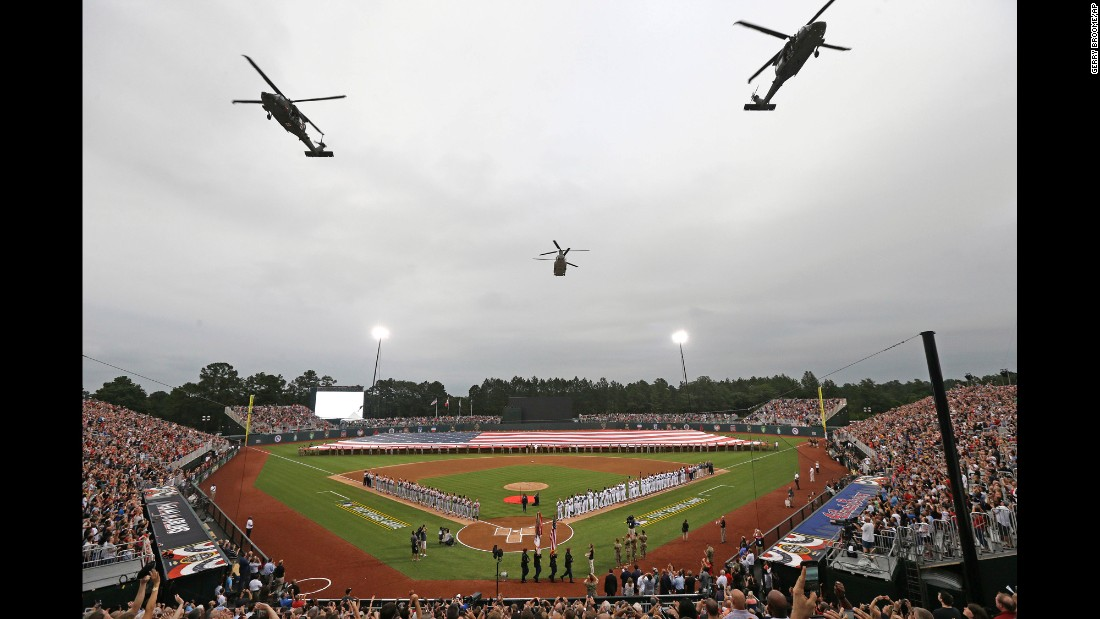 "Military helicopters fly over a field at Fort Bragg, North Carolina, prior to <a href=""http://www.cnn.com/2016/07/01/sport/marlins-braves-at-fort-bragg/"" target=""_blank"">a special Major League Baseball game </a>between Miami and Atlanta on Sunday, July 3. The vast majority of seats were reserved for U.S. service members and their families. <a href=""http://www.cnn.com/2016/06/28/sport/gallery/what-a-shot-0628/index.html"" target=""_blank"">See 27 amazing sports photos from last week</a>"