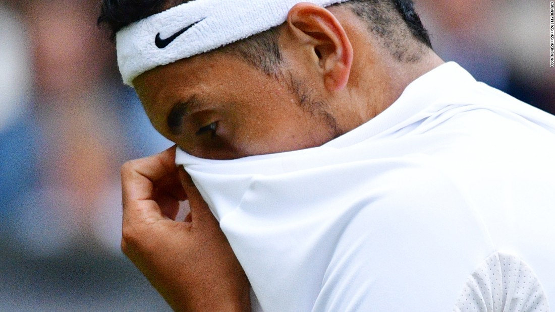 Nick Kyrgios reacts while playing Britain's Andy Murray during their men's singles fourth round match. Australian Kyrgios -- who plays without a coach -- appeared distracted throughout the match.