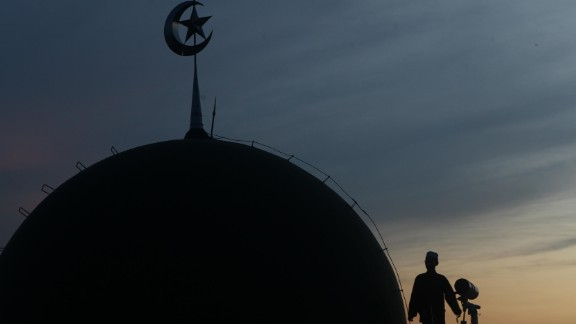Muslims in Jakarta, Indonesia, look for the new crescent moon that determines the end of Ramadan.