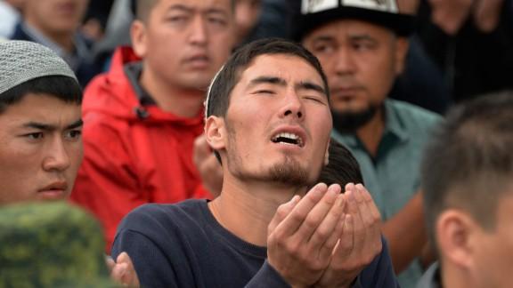 Muslims pray in Bishkek, Kyrgyzstan, during celebrations of Eid al-Fitr.