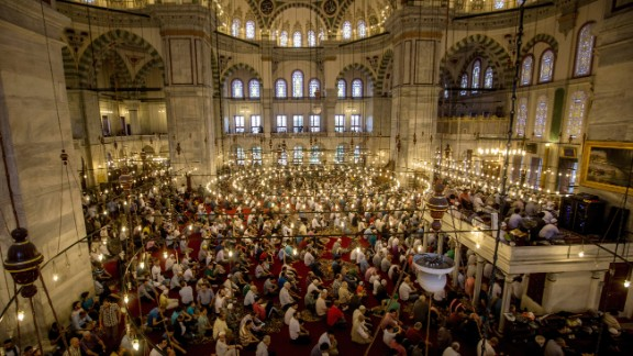 Muslims pray in Istanbul as they mark the first day of Eid al-Fitr.