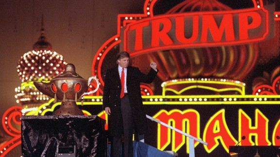 (Original Caption) Atlantic City, New Jersey: Donald Trump raises his fist in a salute as he presides over opening ceremonies of the formal opening of his Taj Mahal, which he calls the 8th wonder of the World.