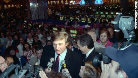 Trump in front of slot machines at the Taj