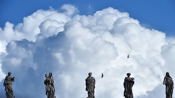 Heavy clouds are seen above statues of the Vatican before the Angelus prayer of Epiphany