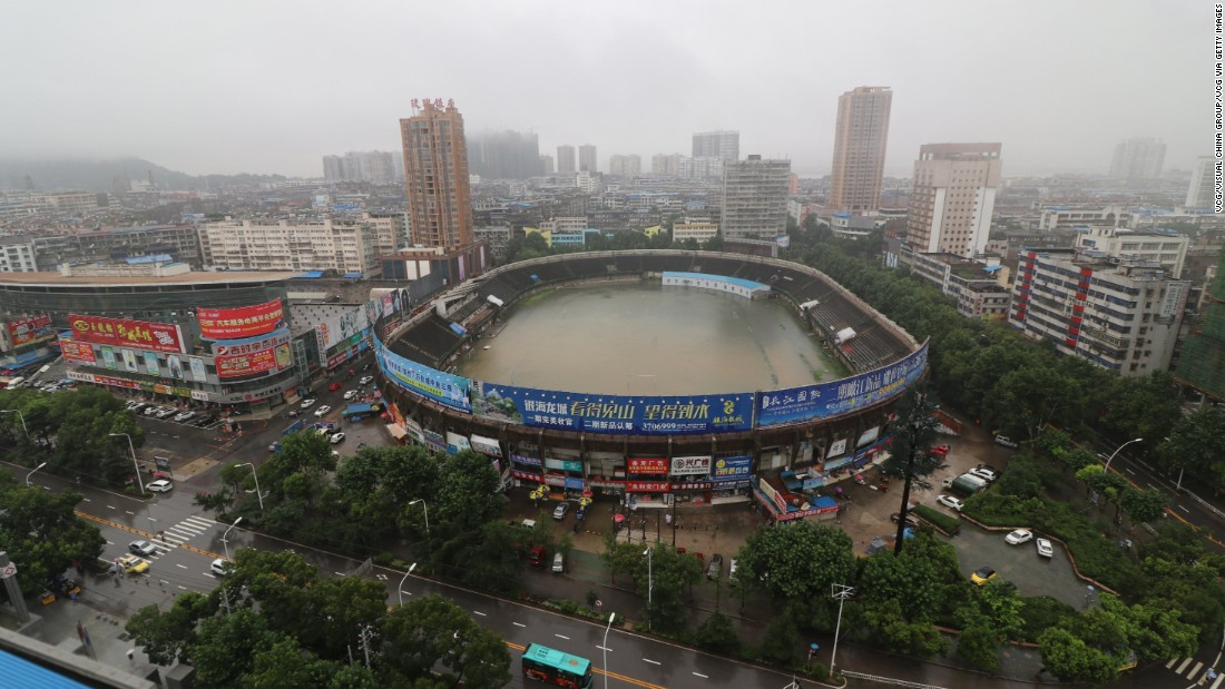 An aerial view of a rain-filled stadium in Ezhou, Hubei, July 2 that resembles a massive bathtub. China has seen 23% more rain than average this year.