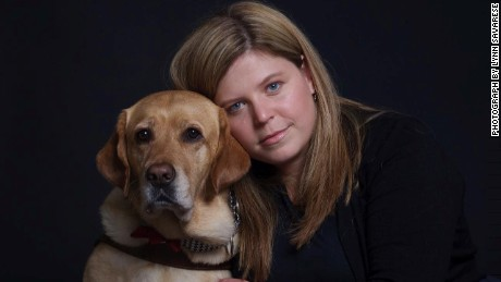 Trafficking survivor and advocate Margeaux Gray with her guide dog, Junebug.