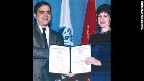 Ana Montes with then-Deputy DCI George Tenet, after receiving an award.