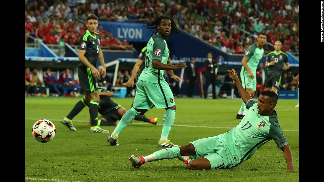 Nani slips a deflection past Welsh goalkeeper Wayne Hennessey.