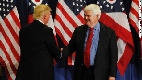 Former Speaker of the House Newt Gingrich (R) shakes hands with Republican Presidential candidate Donald Trump during a rally at the Sharonville Convention Center July 6, 2016, in Cincinnati, Ohio.