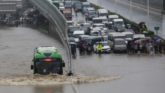 A bus struggles through flood waters on July 6, 2016. Floods and heavy rain paralyzed traffic in Wuhan, a megacity of 10 million on the Yangtze river.