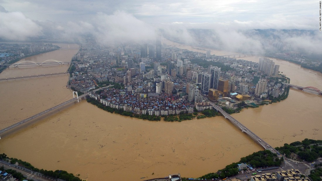 The city of Liuzhou, Guangxi province is surrounded by the swollen Liujiang River July 5.