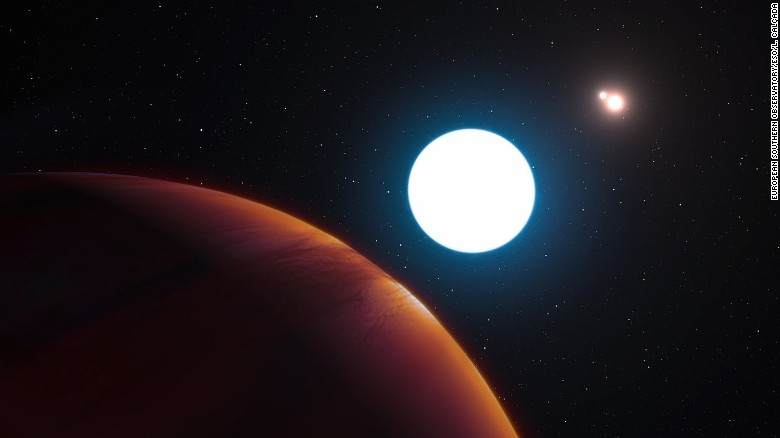 This artist's impression shows a view of the triple-star system HD 131399 from close to the giant planet orbiting in the system. Located about 320 light-years from Earth, the planet is about 16 million years old, making it also one of the youngest exoplanets discovered to date.