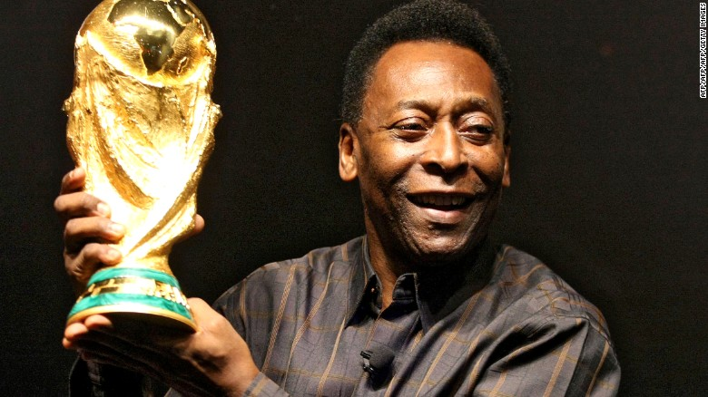 Brazilian football star Pele displays the FIFA World Cup during its presentation in Rio de Janeiro, Brazil on February 6, 2010. The cup is being exhibited in numerous countries while on a tour before reaching South Africa for the FIFA World Cup tournament that will be held next June. AFP PHOTO/GABRIEL LOPES (Photo credit should read GABRIEL LOPES/AFP/Getty Images)