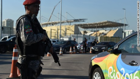 Security is visible at a checkpoint Tuesday at the Olympic Village in Rio de Janeiro.