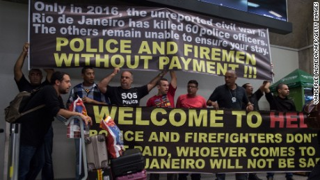 Police and firefighters  protest pay delays this week at Rio de Janeiro's main airport.