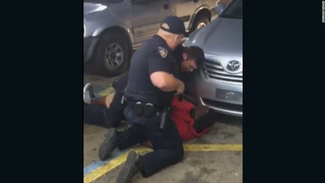 A still image taken from a bystander video of Baton Rouge police officers tackling Alton Sterling before he was fatally shot.