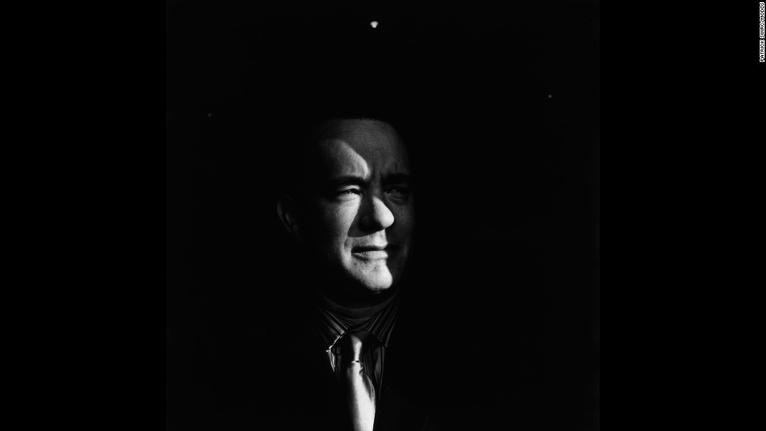 "Swirc photographed actor Tom Hanks at the Deauville American Film Festival in France. Swirc said it usually rains at the festival, but Hanks ""approached the window of opportunity with that little ray of this sun."""