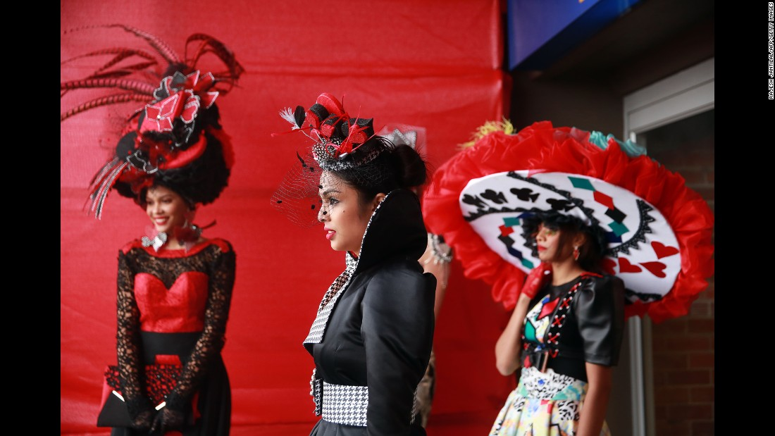 Women showcase outfits from local South African designers at a fashion show that was held before the Durban July horse race on Saturday, July 2.