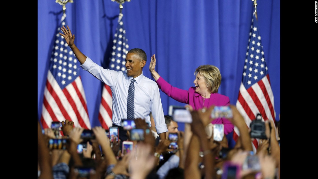 "U.S. President Barack Obama and Democratic presidential candidate Hillary Clinton <a href=""http://www.cnn.com/2016/07/05/politics/obama-clinton-campaign-charlotte/"" target=""_blank"">attend a campaign rally for her</a> in Charlotte, North Carolina, on Tuesday, July 5. Obama said he became a loyal Clinton convert years ago and that their Democratic primary fight is all in the past."
