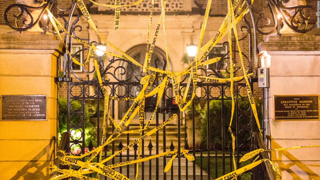 Community members and activists covered the governor's residence with police tape from the scene where Castile was killed.