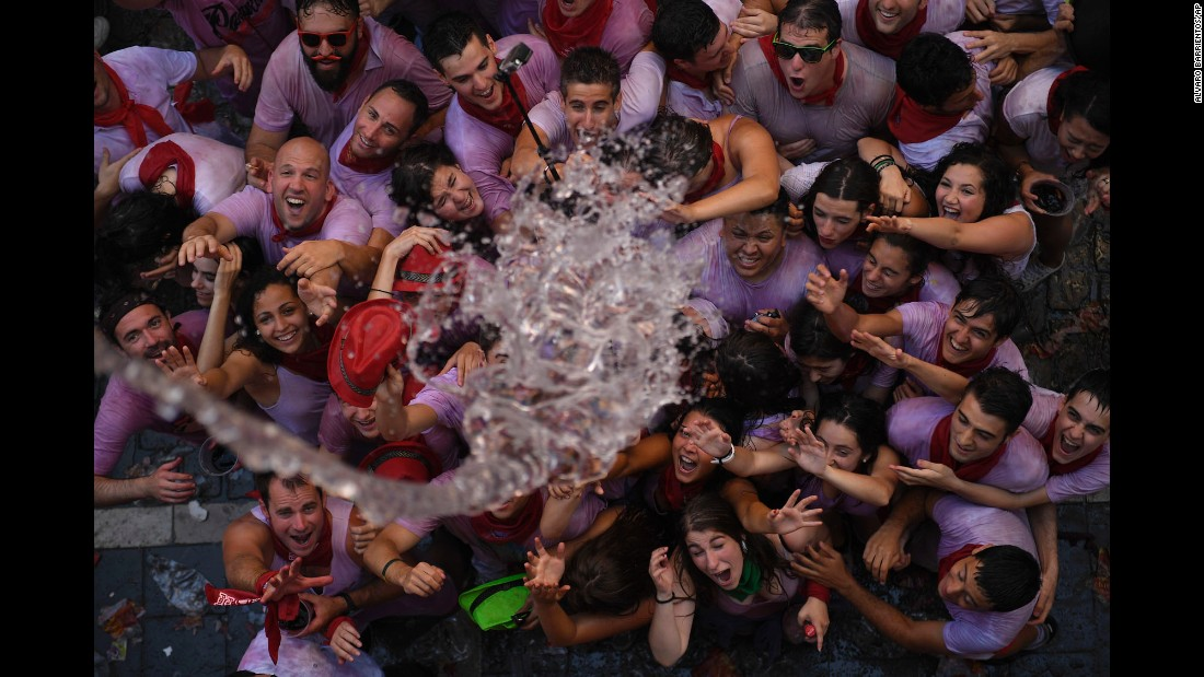 Water is thrown onto revelers during the San Fermin festival in Pamplona, Spain, on Wednesday, July 6.
