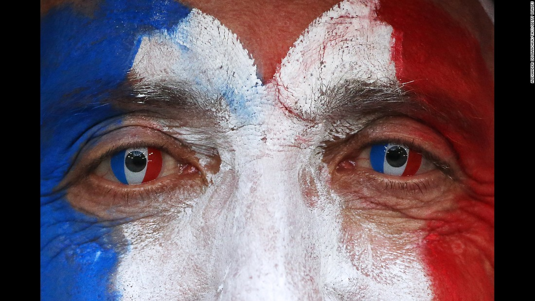 A France fan is ready before the match.
