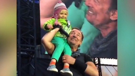 """4-year old sings adorable duet with Springsteen. And gets his harmonica. Jeanne Moos introduces us to Hope.    Springsteen Toddler   Adorableness alert!!! All the bad news getting on your nerves? Overdosed on the election? Watch Bruce Springsteen melt hearts with a 4-year old named Hope. Springsteen invites Hope on stage at a concert in Norway, and she brings down the house with their """"duet"""".  Not only did she have an amazing moment in the limelight, he also gave her his harmonica. We talked to Hope, who tells us (in her ever-so-cute British accent) that her favorite part was when Bruce carried her around on his shoulder. How'd she feel? """"Happy"""" and """"not scared at all."""" What's her message to Bruce? """"I love you."""" Slightly soapy but totally sweet story with great video of these two interacting."""