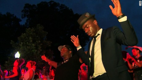 Police shootings protesters sing 'We Shall Overcome'
