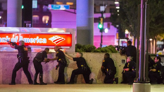 Police respond after shots were fired in downtown Dallas on Thursday, July 7. Five police officers were fatally shot during a protest over recent police shootings in Louisiana and Minnesota. Seven other officers were injured in the ambush, as were two civilians.
