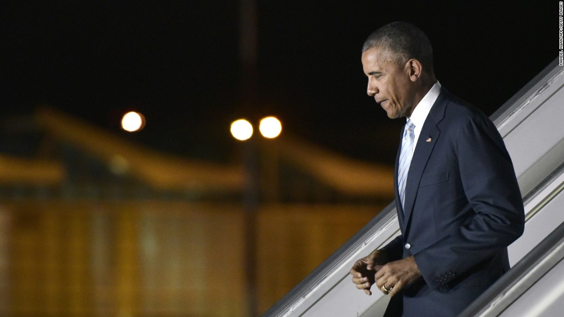 Obama steps off Air Force One upon arrival at Warsaw Chopin Airport in Poland on July 8.