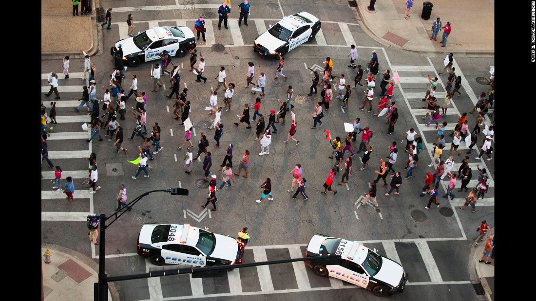 A peaceful Black Lives Matter rally moves through downtown Dallas on Thursday, July 7. Smiley Pool, a photographer with The Dallas Morning News, said what came near the beginning of the demonstration was a scene much different than what came hours later.