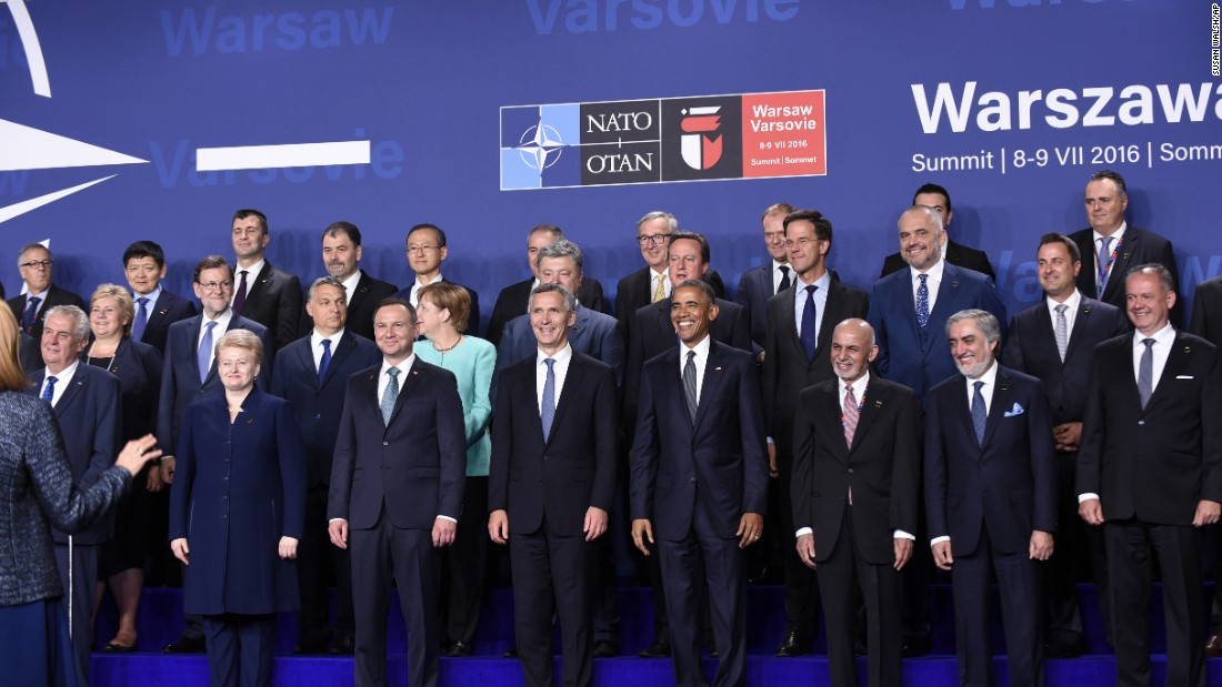 Obama participates in a NATO family photo at PGE National Stadium in Warsaw on Friday, July 8.