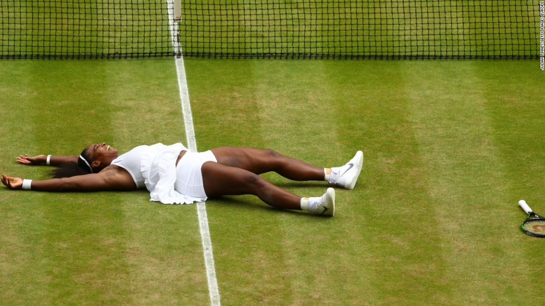 Williams lies on the ground after clinching her victory against Kerber to win Wimbledon for the seventh time.