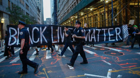 Police officers patrol during a protest in support of the Black Lives Matter movement in New York on July 09, 2016.
