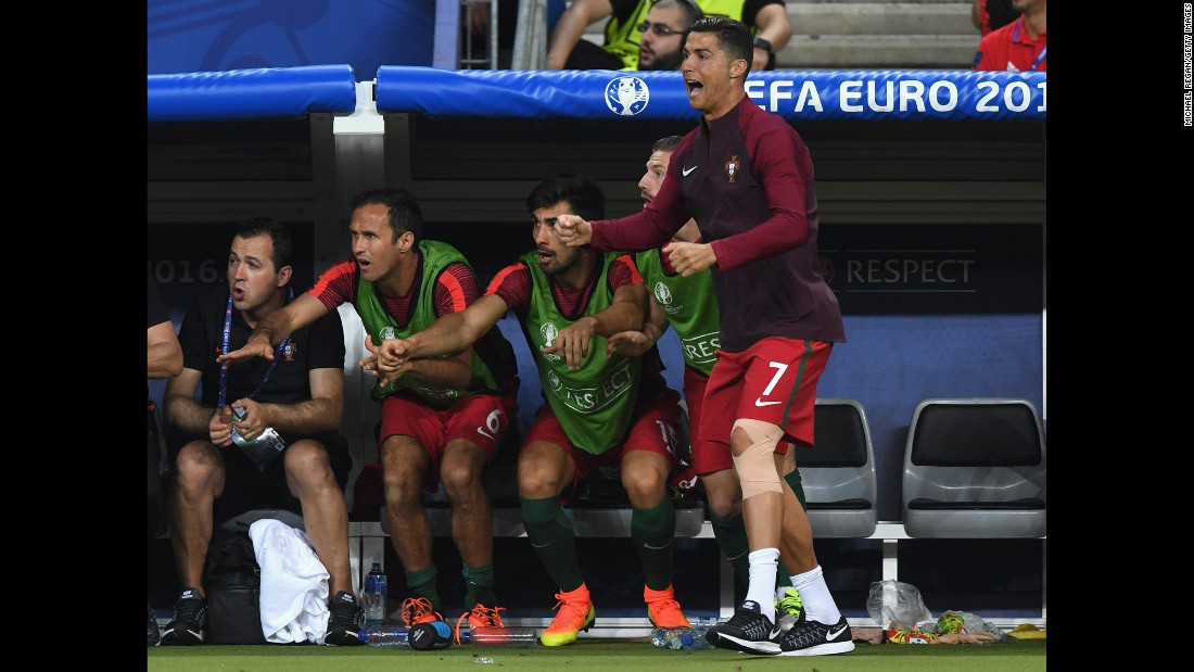 5d947bf18f7 Ronaldo, who had come off injured in the first half, rooted for his  teammates. Photos: Euro 2016 Finals: France Portugal