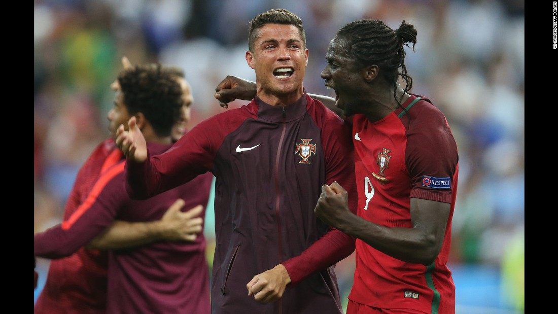 Cristiano Ronaldo celebrated with teammate Eder, the goalscorer, after  Portugal defeated France 1-