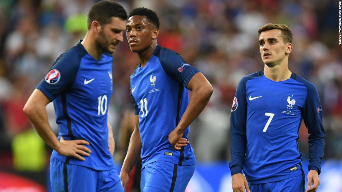 a4855f7aaf1 France's players were left stunned by the defeat which ended its hopes.  Photos: Euro 2016 Finals: France Portugal