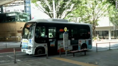 "Edit No4138  Japan's first self-driving bus hits road Japan's first self-driving mini-bus is shown off in Tokyo.  HOWS:  TOKYO, JAPAN (JULY 7, 2016) (REUTERS - ACCESS ALL)  1. DENA AND EASY MILE'S SELF-DRIVING BUS, ROBOT SHUTTLE  2. WHITE SIGN READING (English): ""ROBOT SHUTTLE""  3. SIX SEATS INSIDE THE ROBOT SHUTTLE  4. ROBOT SHUTTLE DOOR CLOSING  5. VARIOUS OF ROBOT SHUTTLE MOVING  6. ROBOT SHUTTLE MOVING UP A SLOPE  7. SHUTTLE DOOR CLOSING  8. VARIOUS OF ROBOT SHUTTLE MOVING  9. VENUE WHERE ROBOT SHUTTLE DEMONSTRATION WAS HELD  10. MEDIA GETTING INSIDE ROBOT SHUTTLE BEFORE IT DRIVES AWAY  11. NEWS CONFERENCE  12. (SOUNDBITE) (Japanese) DENA GENERAL MANAGER OF AUTOMOTIVE BUSINESS, HIROSHI NAKAJIMA, SAYING:  ""Of course the environment is limited but as long as it's within a controlled environment, we can provide an efficient self-driving vehicle. I think companies like this are rare.""  13. NEWS CONFERENCE IN PROGRESS  14. (SOUNDBITE) (Japanese) DENA GENERAL MANAGER OF AUTOMOTIVE BUSINESS, HIROSHI NAKAJIMA, SAYING:  ""We take safety very seriously. Because we worry that there may be a serious accident, we take double or triple safety checks and begin from there.""  15. NEWS CONFERENCE IN PROGRESS  16. LOCAL BUS SIGN  17. LOCAL BUS PULLING UP AT A BUS STOP  18. PEOPLE GETTING OFF A LOCAL BUS  STORY: Japanese tech-firm DeNA showcased its first self-driving bus in downtown Tokyo on Thursday (July 7). The EZ10 Robot Shuttle runs entirely on electricity and can be ridden by up to 12 people.  Equipped with a lift, the Robot Shuttle provides improved access to senior citizens and those with disabilities. With no driver, it runs on a pre-determined route set by its Global Positioning System (GPS) and external cameras. The bus weighs 1,700 kg (3.748 lb) and has a maximum speed limit of 40 km/h (25 mph). It is 3.92 metres (12.86 feet) long, has a width of 1.986 metres (6.51 feet), and is 2.750 metres (9.02 feet) high.  The EZ10 contains aluminium and fibreglass components in its body work, making it lightweight and durable. T"