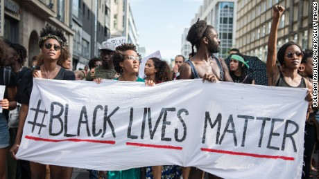"Protestors hold a banner reading ""Black Lives Matter"" during a demonstration in Berlin, on July 10, 2016 with the motto ""Black Lives Matter - No Justice = No Peace"" as protest over the deaths of two black men at the hands of police last week. / AFP / dpa / Wolfram Kastl / Germany OUT        (Photo credit should read WOLFRAM KASTL/AFP/Getty Images)"