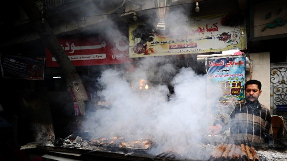 """""""Bad diets are a big problem affecting all countries. We estimate that one in three people has a poor diet,"""" says lead author, Dr Lawrence Haddad, executive director at the Global Alliance for Improved Nutrition (GAIN).  Pictured here, a street food vendor cooks kebabs in downtown Cairo, Egypt."""