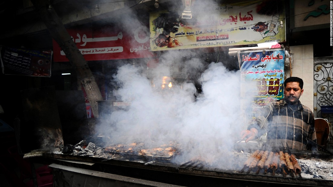 """Bad diets are a big problem affecting all countries. We estimate that one in three people has a poor diet,"" says lead author, Dr Lawrence Haddad, executive director at the Global Alliance for Improved Nutrition (GAIN).<br /><br />Pictured here, a street food vendor cooks kebabs in downtown Cairo, Egypt."